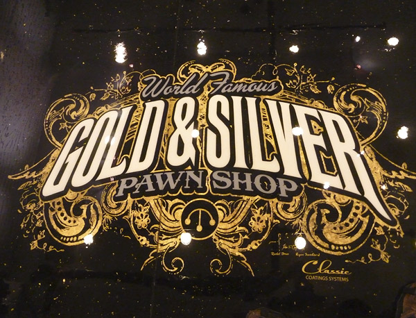Pawn Shop concrete logo in Las Vegas store made with real gold leaf on black epoxy coating.
