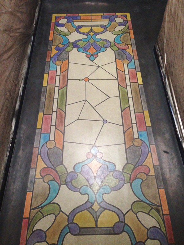 stained glass looking window on floor