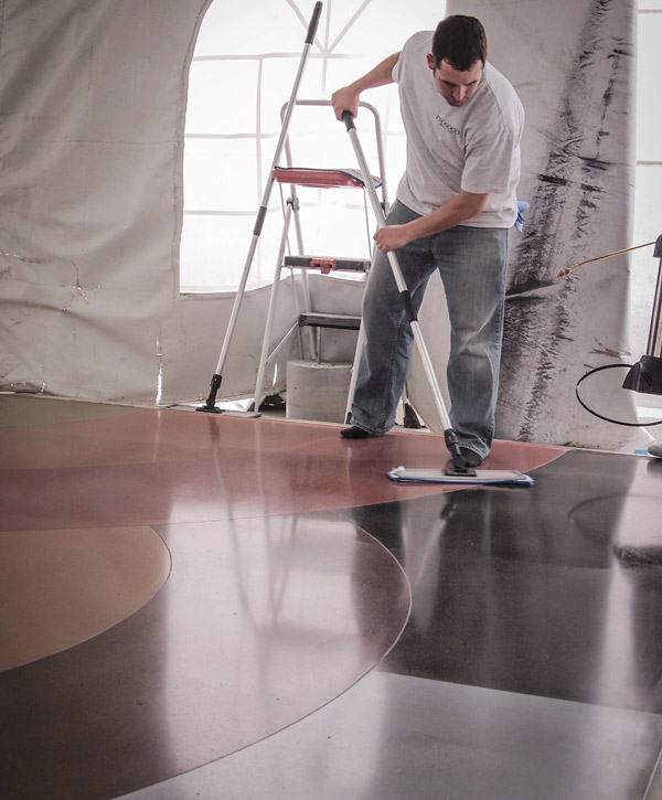 "A silane-modified protective ""guard"" product, or sealer, is applied to a polished concrete floor. Many sealer options are available for decorative concrete applications, including acrylics, epoxies, polyurethanes, polyaspartics and polyureas. Photo courtesy of Prosoco"