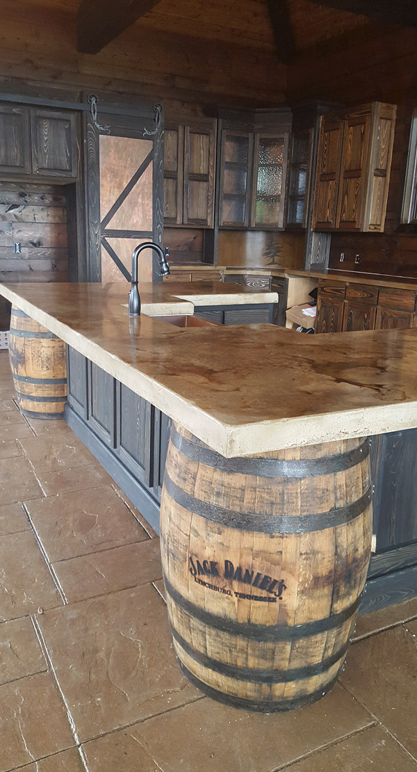 Cast in place whiskey colored concrete countertops in a Stone-Crete Artistry, Whiskey Kitchen, Jack Daniels barrels
