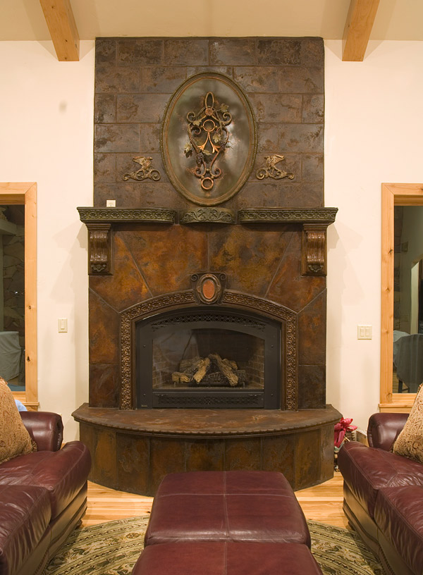 Gorgeous concrete fireplace surround and heath featuring concrete that is stained a rustic dark brown.