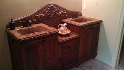 Tiered bathroom vanity made of concrete with antique details.