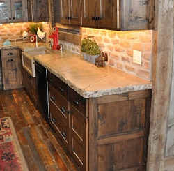 Kitchen sink and concrete countertop by Ben Ashby.