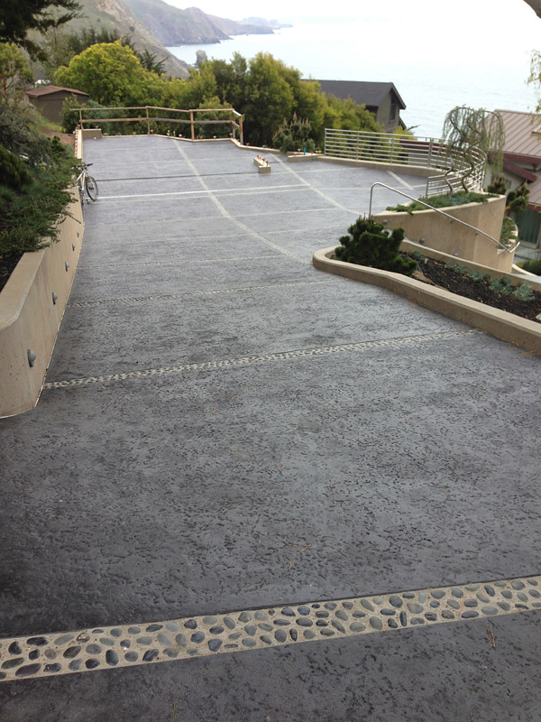 A long expanse of exterior concrete can look quite impressive, but lack of maintenance can lead to cracking, pitting and spalling. Photo courtesy of Bay Area Concretes