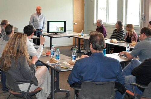 Group of architects listening to a presentation about decorative concrete