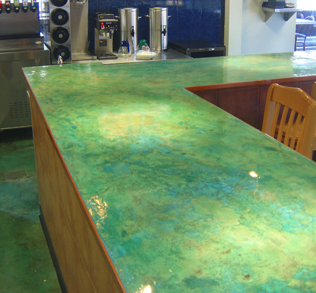 Blue green concrete countertop coated with epoxy.