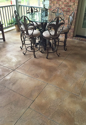 Ashlar patterned concrete covered patio