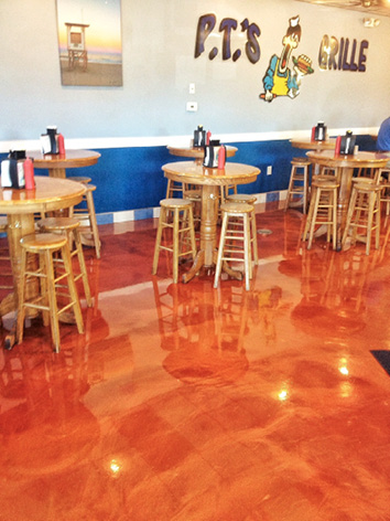 Burnt orange metallic epoxy floor coating at PT's Grille