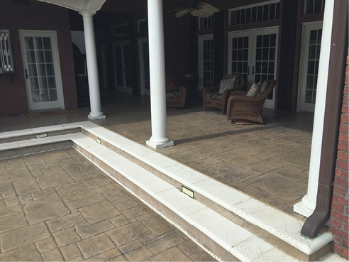 stamped concrete patio with white stairs