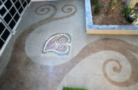 A patio that has been engraved and colored to add life to an otherwise drab space,