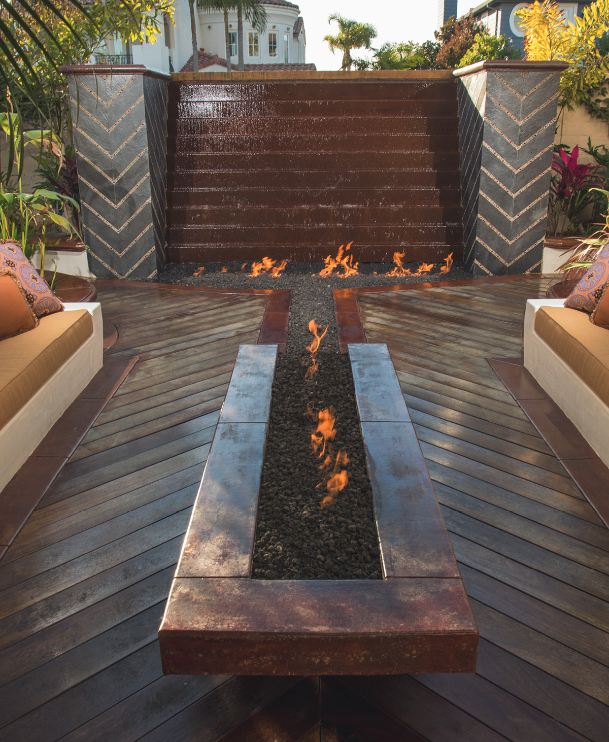outdoor patio with concrete fireplace and waterfall