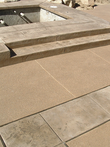 light architectural exposed aggregate and stamped concrete