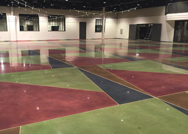 The crisp, detailed line work required more than 2 miles of tape and plastic. The new section's colors and pattern were achieved with a four-dye combination to match the existing floors.