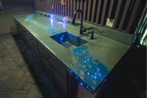 Countertops have blue veins and more than 300 individual fiber optics that twinkle like stars. Large bronze snakes with blue LED eyes slither across green backsplashes.