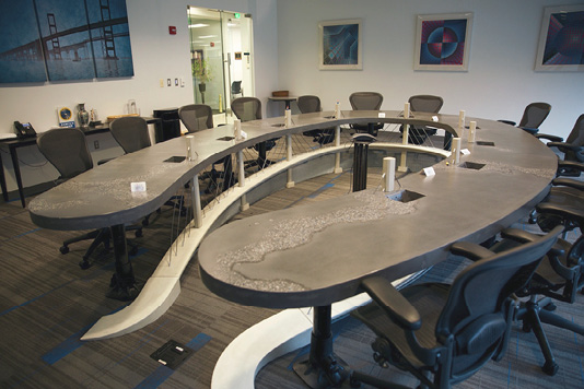 This 17-by-11-foot table serves as the centerpiece of a new corporate headquarters, with ample seating room for a dozen or more.