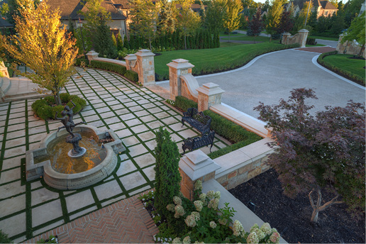 About 3,000 square feet of concrete was placed for the driveway, with the bands poured separately and finished with a limestone texture.
