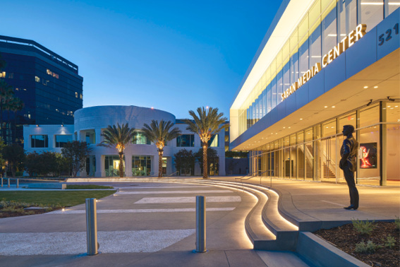 The theater and media center feature radius stairs, planter walls, curbs and nearly 15,000 square feet of sand-finished paving with alternating bands of hand-seeded white aggregate.