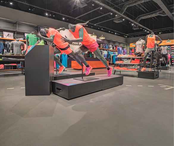 Sports apparel store in Italy uses polished concrete floors to enhance its products.