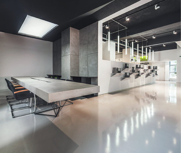 Polished white concrete floors in a meeting space in Italy.