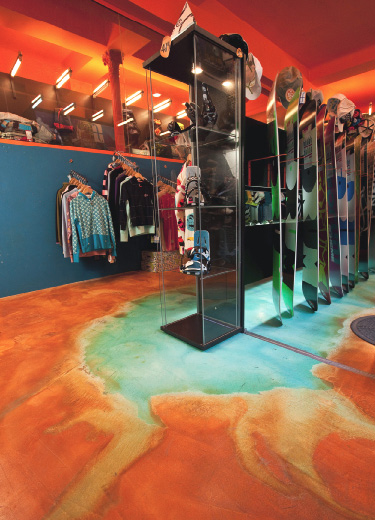 Bright blue and orange stained concrete floor in an Italian boutique.