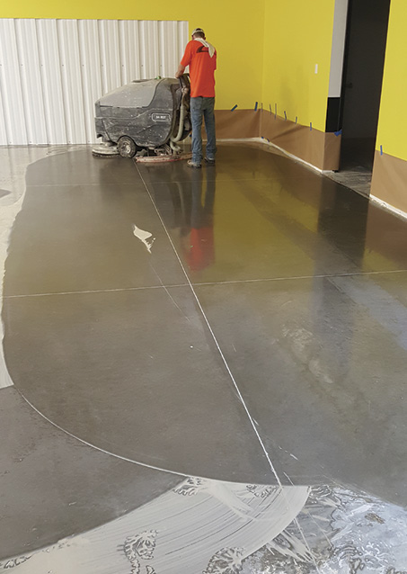 It's important to clean the floor between grinding stages. Photo courtesy of Curecrete Distribution