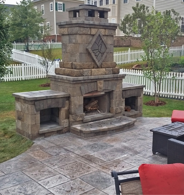 Large outdoor fireplace with wood storage on each side of the main fire site.