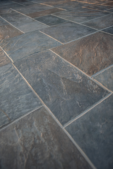 This stamped concrete could fool a tile setter to think this was actual slate rectangular tiles.