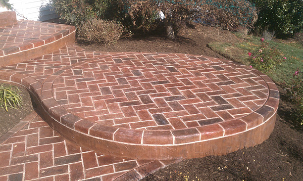 Brick look concrete overlay on a multi step porch entrance.