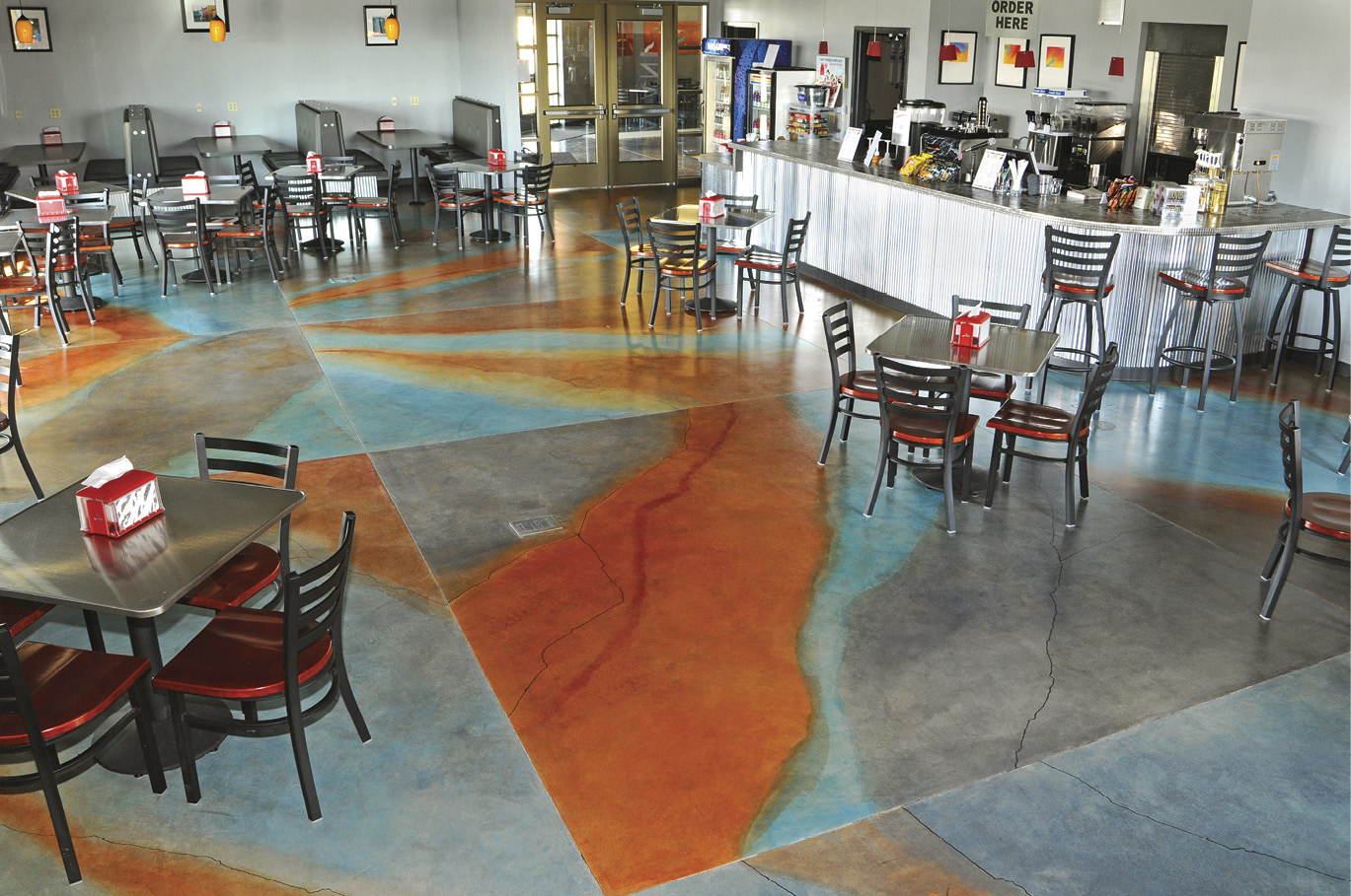This restaurant floor, done in ARTesian Water-Based Stains, showcases both the durability of the product and the wide range of colors available. The compass below displays the colorful hues in more muted tones.