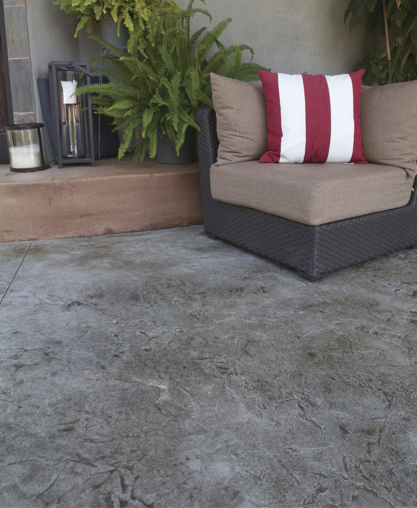 With as little as one quarter inch of material, such as the Stamp-It overlay from Westcoat, a plain concrete patio can be transformed into an expanse of textured concrete with a custom blend of colors.