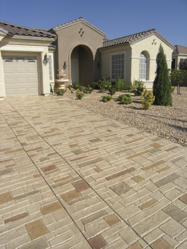 California home with a stamped concrete overlays system on it's driveway.