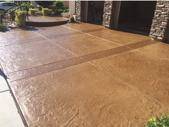 A formerly drab concrete driveway comes alive with an Italian slate pattern.