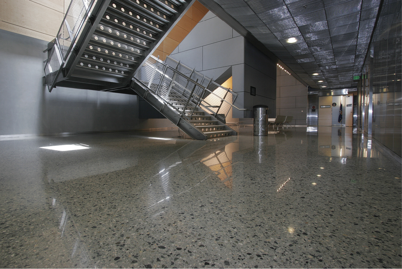 Ground and polished concrete floor in an industrial style business office building.
