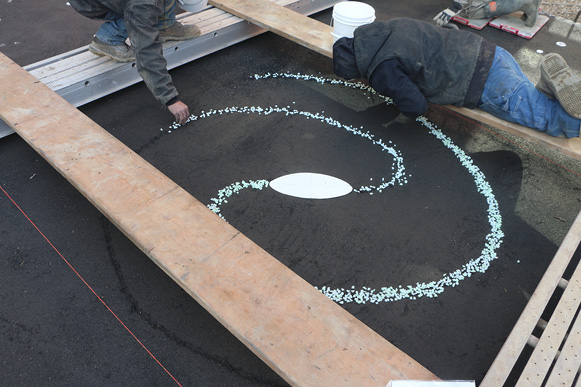 "Geiser says the concrete used there is integrally colored with a Deco-Crete dark gray liquid colorant and a black shake-on color hardener. ""I knew we were going to grind and I wanted the surface to be as black as possible,"" he says. ""And the only way to get it super black is to use a color hardener."""