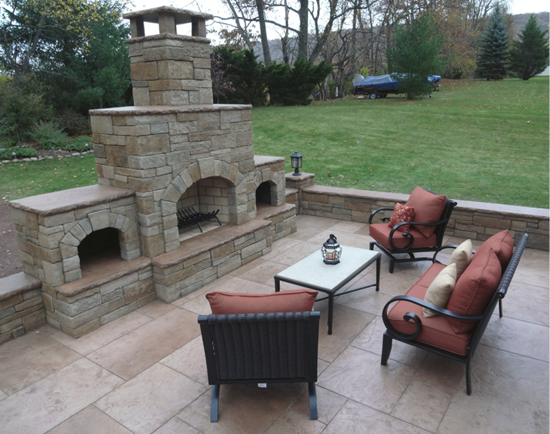 Outdoor Rooms like this feature a fireplace and a sitting area to relax