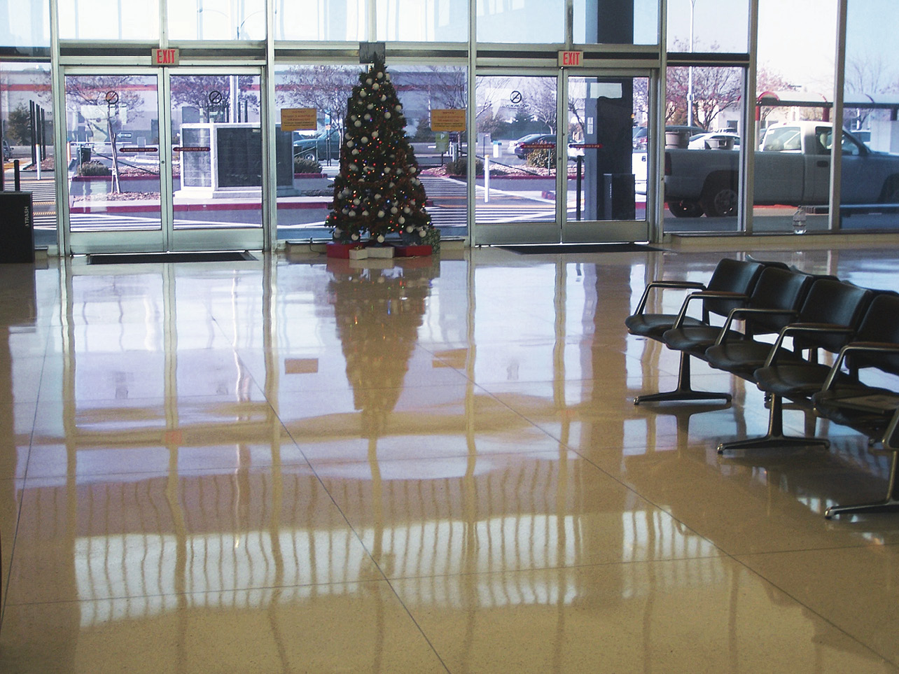 Making the switch to polished floors has paid off for Stockton Metropolitan Airport in California. Seen here is the lobby after it was polished. The photo on the next page is what it looked like before.