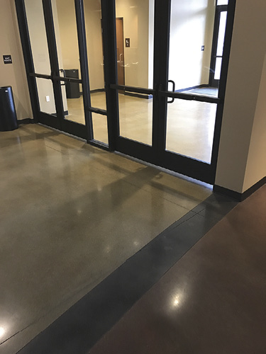 Surfacing Solutions completed staining and polishing the interior lobby area, but learned of the geometric miscalculation when the exterior flatwork was completed and the lines missed the mark.