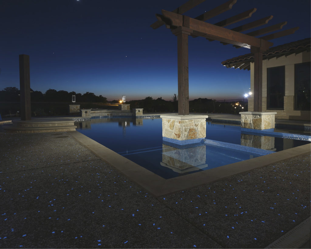 Exposed aggregate of the pool deck has also included glow in the dark stones.