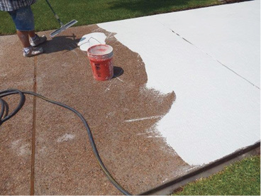 A scratch coat of limestone overlay is applied over pea gravel-exposed aggregate.