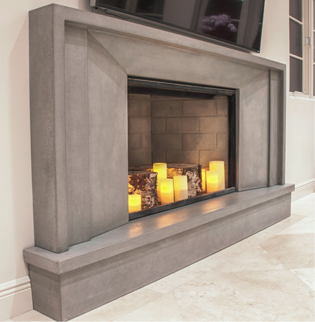 Concrete hearth and surround for modern fireplace.