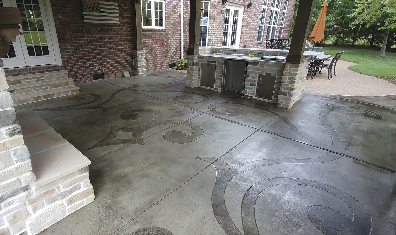 Finished concrete art scrolling concrete stained outdoor kitchen area.
