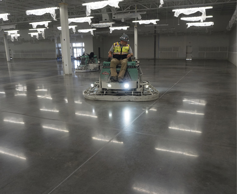 Besides efficiency and profitability gains for contractors using power trowel polishing systems, users of these systems point to the benefit of accelerated turnaround for the general contractor and owner. Photo courtesy of The Art of Concrete