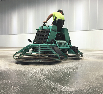 Power trowel systems put polished concrete in a stronger competitive position with VCT on big projects, users say.