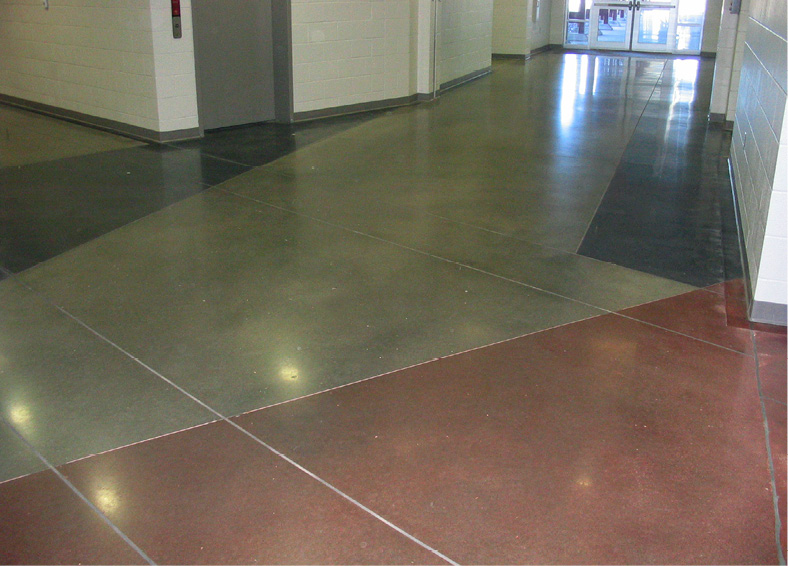 Without a stain-protecting layer, colored/dyed areas of polished concrete flooring typically have chips that appear on the surface.