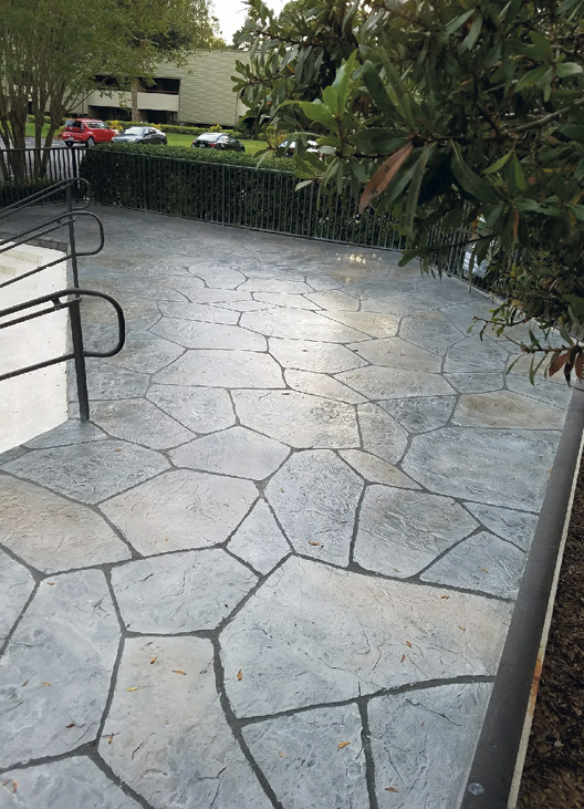 Concrete overlay flagstone project that involved a scratch coat of Stone Edge Pro Bond top-coated with Stone Edge Pro Stamp Mix, an overlay which was stamped, carved and colored.Photo courtesy of Stone Edge Surfaces