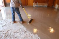 Self-Leveling Concrete Compound being spread on concrete