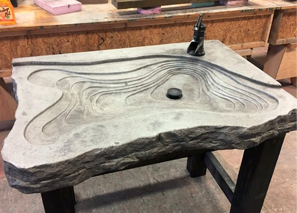 Free standing grey concrete sink. Sediment layered look with a broken rock face edging. Photos courtesy of Concrete In-Counters concrete sink