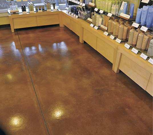 A microtop was put on with Increte's Level Top SP, acid stained with Stain-Crete and finished with a water-based urethane. self-levelers