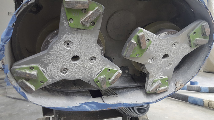 When it comes to mechanical surface preparation, more and more contractors are using concrete polishing grinders. There's no problem with this method if the correct type of tooling is used. Photo courtesy of Chris Sullivan