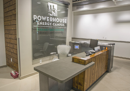 Reception counter made from precast concrete compliments the PowerHouse energy campus.